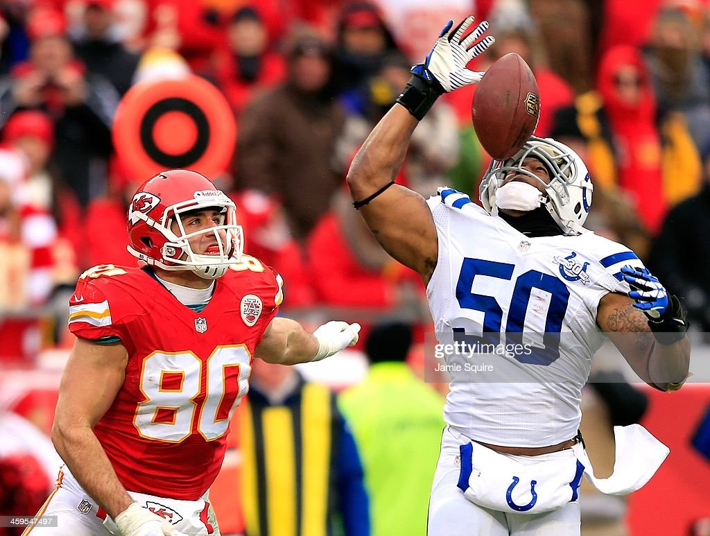 Inside linebacker <a gi-track='captionPersonalityLinkClicked' href=/galleries/search?phrase=Jerrell+Freeman&family=editorial&specificpeople=5441871 ng-click='$event.stopPropagation()'>Jerrell Freeman</a> #50 of the Indianapolis Colts intercepts a pass intended for tight end <a gi-track='captionPersonalityLinkClicked' href=/galleries/search?phrase=Anthony+Fasano&family=editorial&specificpeople=620269 ng-click='$event.stopPropagation()'>Anthony Fasano</a> #80 of the Kansas City Chiefs during the game at Arrowhead Stadium on December 22, 2013 in Kansas City, Missouri.
