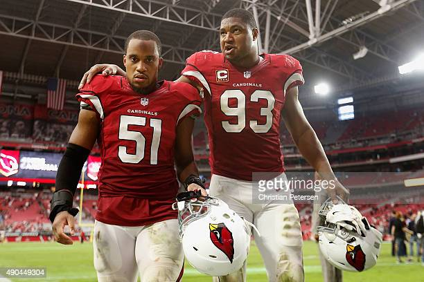 Inside linebacker Kevin Minter and defensive end Calais Campbell of the Arizona Cardinals walk off the field following the NFL game against the San...