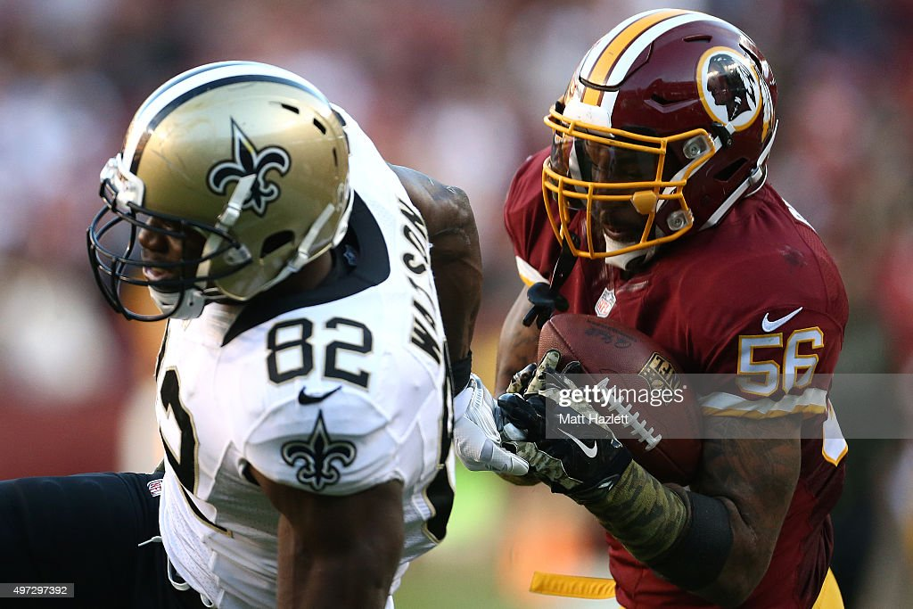 Inside linebacker Perry Riley of the Washington Redskins catches a fourth quarter interception over tight end Benjamin Watson of the New Orleans...