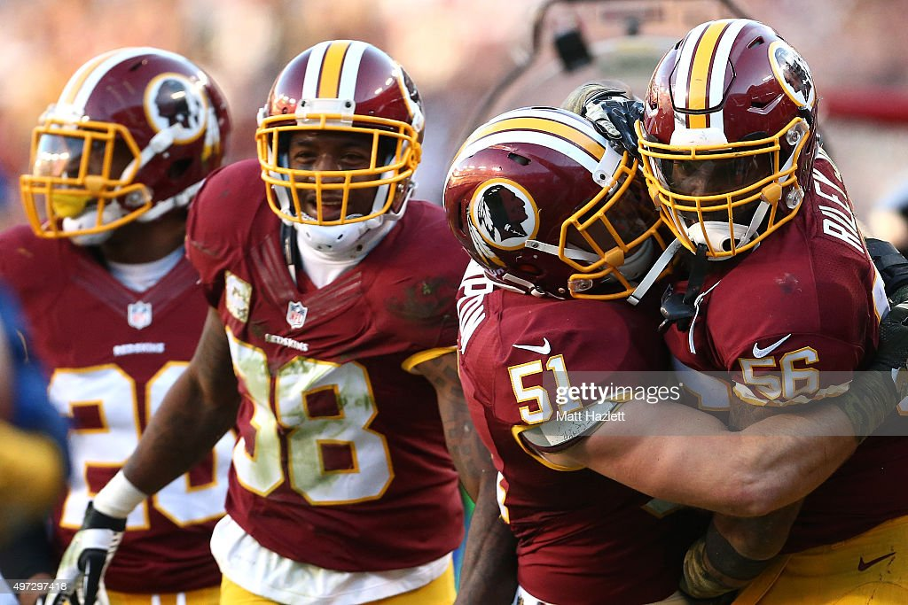 Inside linebacker Perry Riley of the Washington Redskins celebrates with inside linebacker Will Compton of the Washington Redskins after a fourth...
