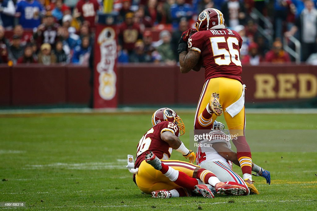 Inside linebacker Perry Riley of the Washington Redskins intercepts the ball over running back Shane Vereen of the New York Giants in the first...