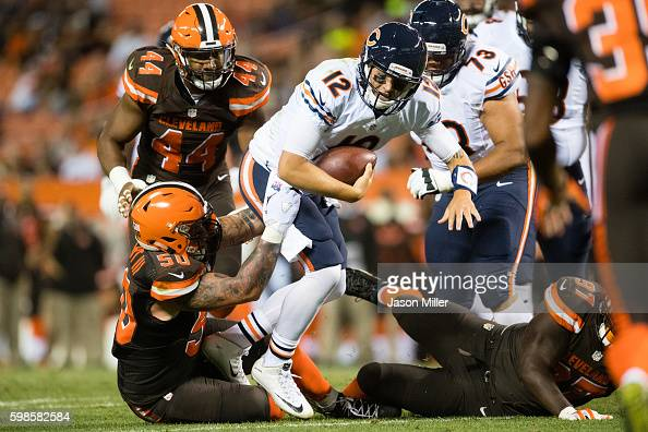 Inside linebacker Scooby Wright of the Cleveland Browns sacks quarterback David Fales of the Chicago Bears during the third quarter during a...