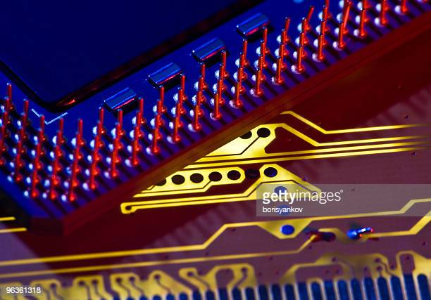 Inside of a circuit board with gold filaments