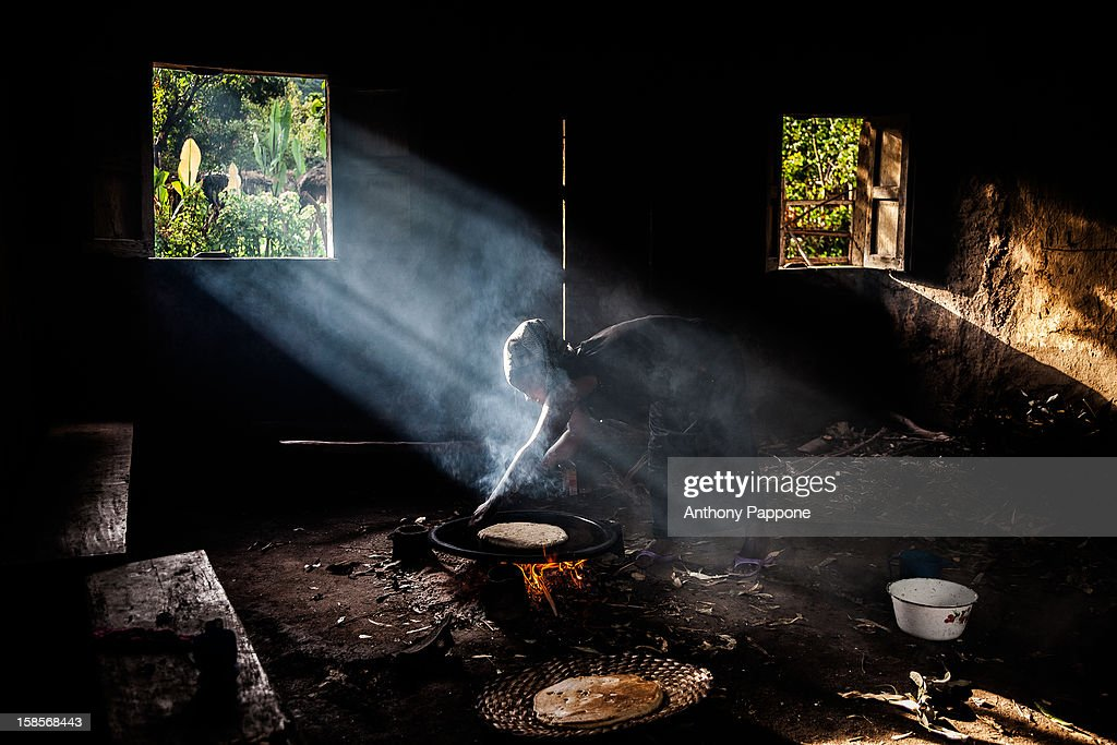 CONTENT] Inside of a hut the woman make the bread on the fire. the village neae jinka, omo valley, ethiopia