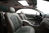 grey colored leather car seats, seatbelts, dashboard of the car from side view