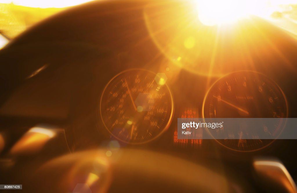 Inside of driver's seat portraying love & enjoyment of driving. Lens flare from the late afternoon sun and blurred motion effects dramatically enhances this feeling.