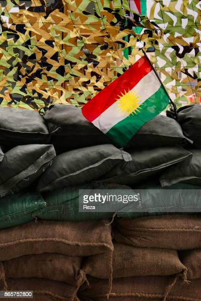 Inside the Black Tiger Camp a Kurdish flag flies above the sandbags that protect the position designated as Sultan Abdullah the most advanced outpost...
