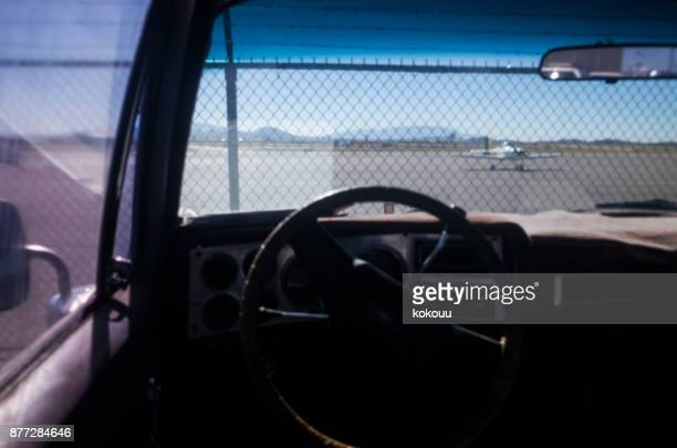 Inside the car and the airport.