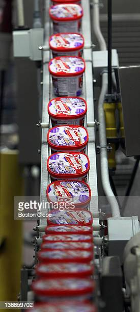 Inside the Friendly's plant finished cartons of a limited edition ice cream flavor called 'Purple Cow' move quickly along a conveyor belt on the way...