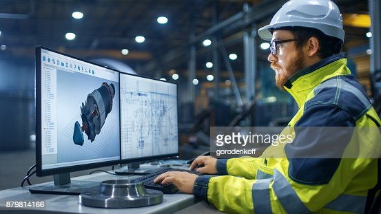 Inside the Heavy Industry Factory Industrial Engineer Works on the Personal Computer Designing Turbine/ Engine in 3D, Using CAD Program. : Stock Photo