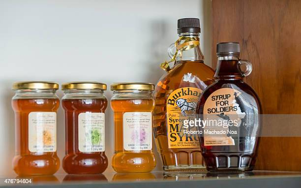 Inside the Mayor's office different maple syrup bottles in shelf John Tory government