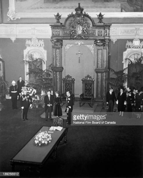 Inside the Quebec Parliament's Legislative Council Chamber Their Royal Highnesses the Princess Elizabeth and Prince Philip Duke of Edinburgh are...