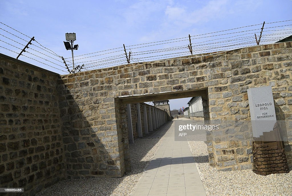 Inside wall and previously electrified barbed wires are seen at the World War II concentration camp of Mauthausen, on April 17, 2013.