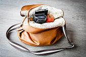 inside woman leather handbag on the wooden floor