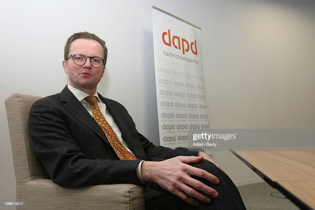 Insolvency lawyer Christian Koehler-Ma arrives for a news conference on December 21, 2012 in Berlin, Germany. The financial newswire Dow Jones is to replace Associated Press as an international distribution partner for the insolvent news agency dapd. Former CEO of N24 television Ulrich Ende is serving as a new investor in Germany's second-largest news agency, which declared bankruptcy in October and fired one hundred, or one-third, of its employees the following month.