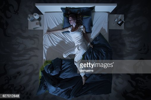 insomnia and nightmare in bed at night : Foto de stock