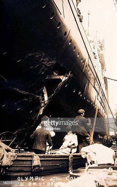 Inspecting the damage to the RMS Olympic after its collision with the British warshiip HMS Hawke off the Isle of Wight on 20th September 1911