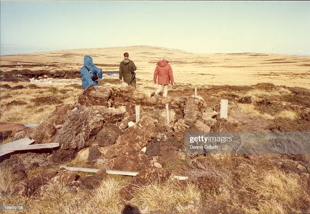 CONTENT] Inspecting the remains of a defensive position in the hills outside of Stanley.