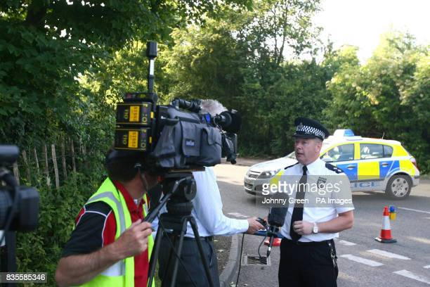 Inspector Brian Cooper from Thames Valley Police speaks to journaists as police close a road in Sutton Courtenay near Abingdon in Oxfordshire close...