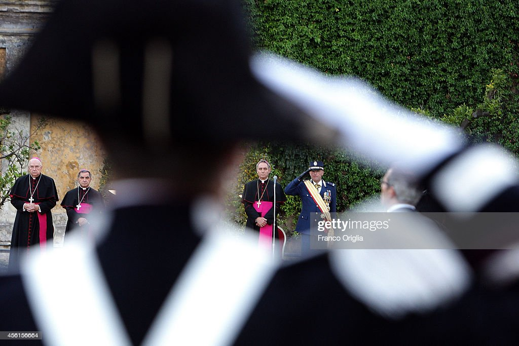 Inspector General Domenico Giani (R) flanked by Prefect of the Pontifical House and former personal secretary of Pope Benedict XVI, Georg Ganswein attend the celebration of San Michele Arcangelo patron Saint of Gendarmerie Corps of Vatican on September 26, 2014 in Vatican City, Vatican. The Gendarmerie Corps of Vatican City State is responsible for security, public order, border control, traffic control, criminal investigation, and other general police duties in Vatican City. The 130-member corps is led by Inspector General Domenico Giani.