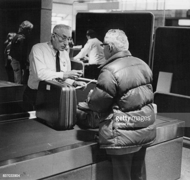 Inspector Gwinn Checks Baggage Denverbound traveler is in customs in Calgary Credit Denver Post