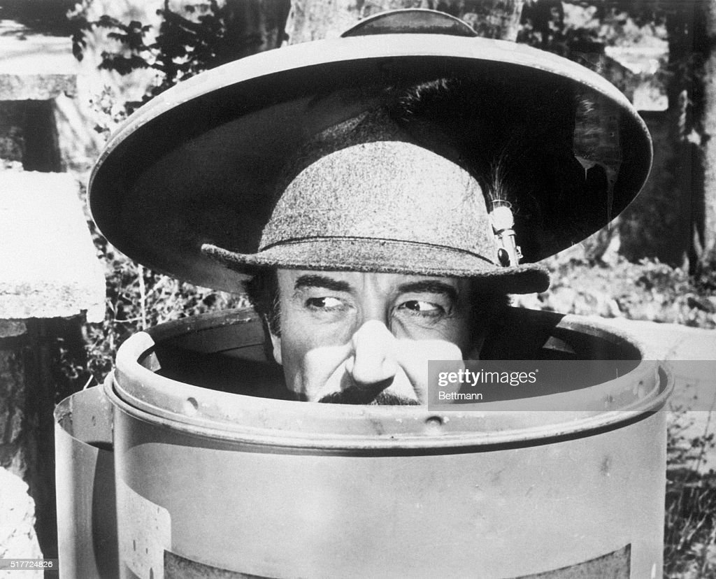 Inspector Jacques Clouseau (Peter Sellers) hides in a trash can in The Pink Panther Strikes Again.