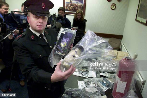 Inspector Mark Kernoghan of the RUC with devices discovered at a loyalist bomb factory in north Belfast on 11/02/01 Officers found component parts...