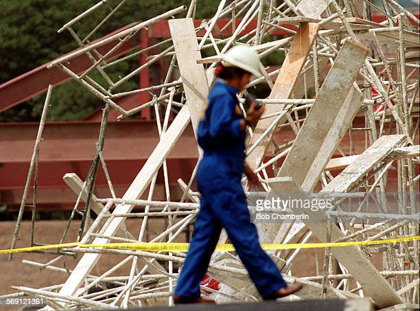 OSHA inspector walks perimiter of scene where five men were injured one seriously when scaffolding they were working from collapsed around 800 am and...