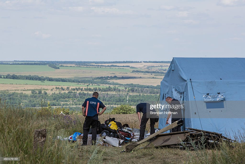 Inspectors from the Dutch government examine items at the Malaysia Airlines flight MH17 crash site on July 21, 2014 in Grabovo, Ukraine. Malaysia Airlines flight MH17 was travelling from Amsterdam to Kuala Lumpur when it crashed killing all 298 on board including 80 children. The aircraft was allegedly shot down by a missile and investigations continue over the perpetrators of the attack.