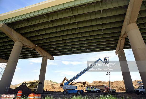 Inspectors survey the I495 bridge over the Christina River June 4 2014 in Wilmington Delaware The bridge was closed indefinitely after four support...