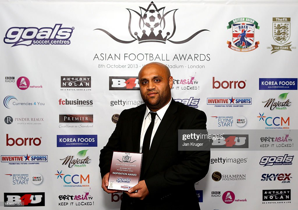 Inspiration Award winner Irfan Kawri poses during the Second Annual Asian Football Awards at Wembley Stadium on October 8, 2013 in London, England.