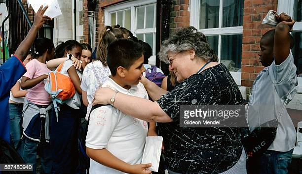 Inspirational head teacher Anna Hassan emotionally embraces and bids farewell to some of the older departing pupils on the last day of their school...