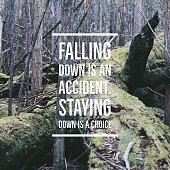 "Inspirational quote ""Falling down is an accident.Staying down is a choice""on forest background with vintage filter"