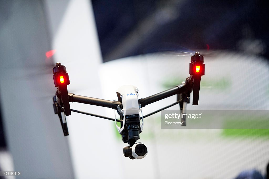 Inspire 1 drone, manufactured by SZ DJI Technology Co., flies during the 2015 Consumer Electronics Show (CES) in Las Vegas, Nevada, U.S., on Wednesday, Jan. 7, 2015. This year's CES will be packed with a wide array of gadgets such as drones,connected cars, a range of smart home technology designed to make everyday life more convenient and quantum dot televisions, which promise better color and lower electricity use in giant screens. Photographer: David Paul Morris/Bloomberg via Getty Images