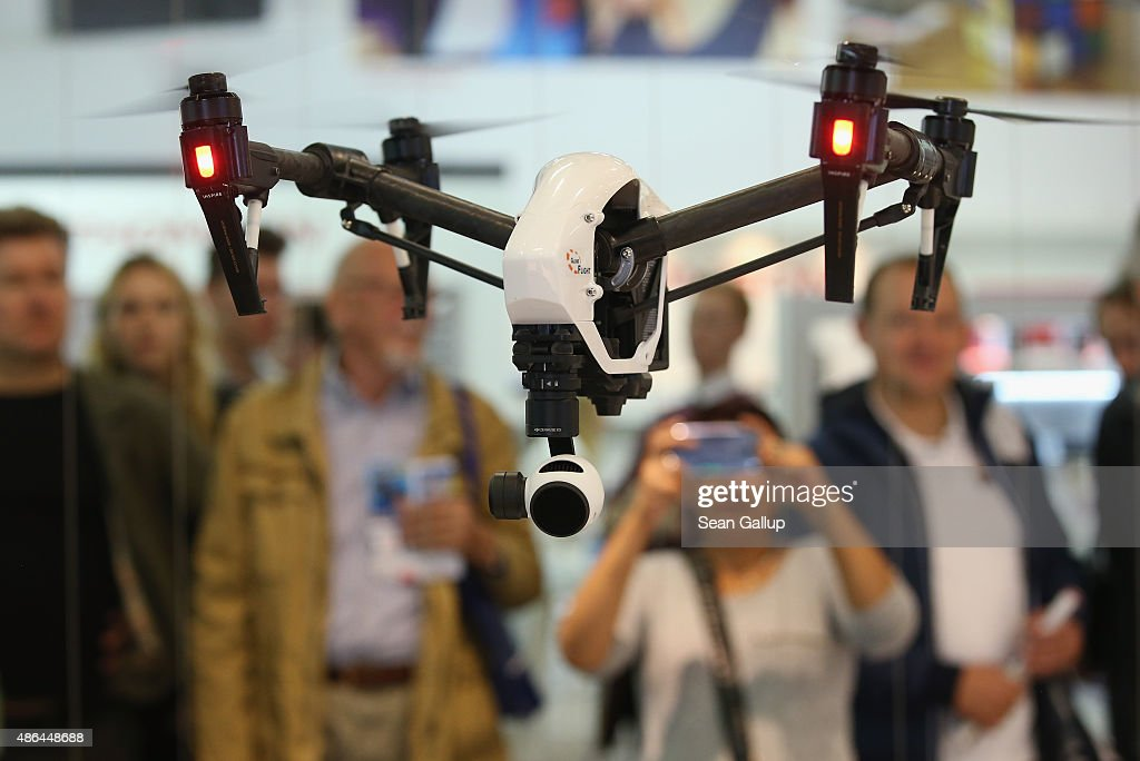 Inspire 1 quadcopter drone flies at the DJI stand at the 2015 IFA consumer electronics and appliances trade fair on September 4, 2015 in Berlin, Germany. The 2015 IFA will be open to the public from September 4-9.