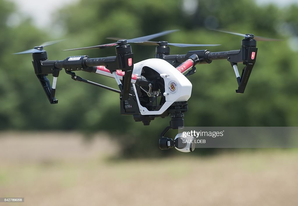 Inspire drone flies at a testing site for the University of Maryland's Unmanned Aircraft Systems (UAS) programs in Bushwood, Maryland, June 24, 2016. The Federal Aviation Administration has unveiled new rules that clear the way for small, commercial drones to operate across US airspace. Drone operators will be allowed to fly commercial craft weighing less than 55 pounds (25 kilograms) during daylight hours, provided they can maintain a clear view of the drone at all times. / AFP / SAUL