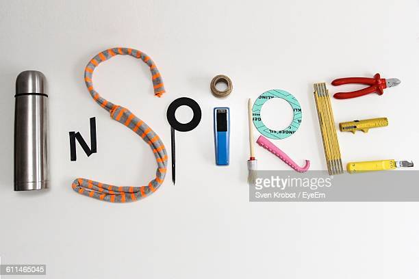 Inspire Text Made Of Various Tools On White Background