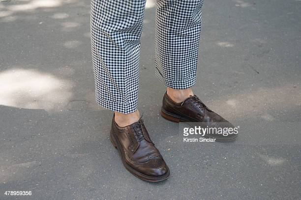Instagrammer Patrick Janelle wears Kitsune suit and J Crew shoes on day 2 of Paris Collections Men on June 25 2015 in Paris France