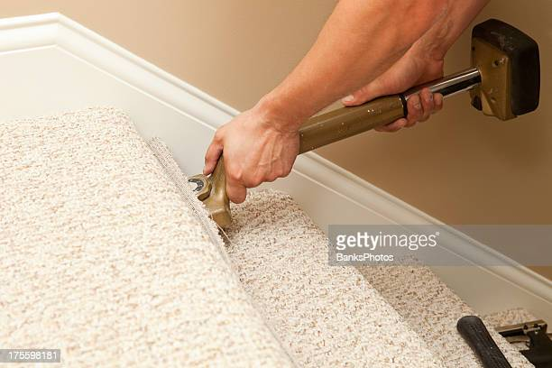 Installer Using Carpet Stretcher on Stairs