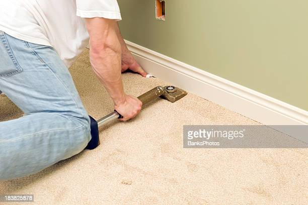 Installer Using Knee Kicker to Stretch Bedroom Carpet