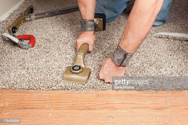 Installer Using Knee Kicker to Stretch Threshold Carpet