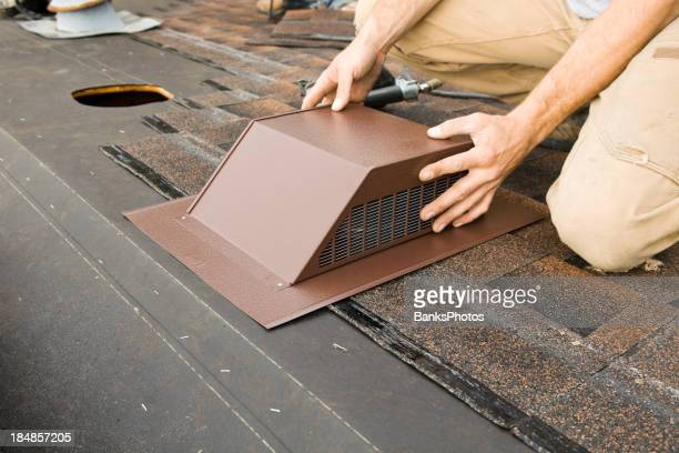 Installing Attic Vent on Home Roof Replacement Project