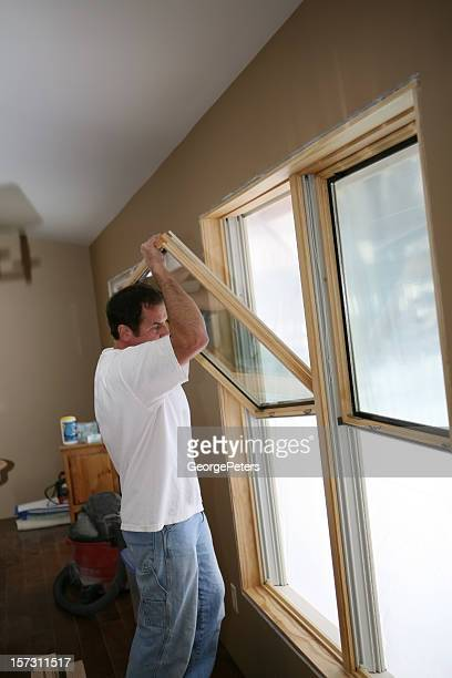 Installation stock photos and pictures getty images for Installing new windows