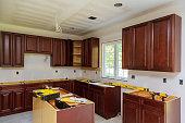 Installing new induction hob in modern kitchen Installation of kitchen cabinet.