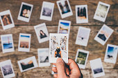 Instant camera prints on a table. Top view.