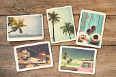 Summer photo album on wood table. instant photo of vintage camera - vintage and retro style