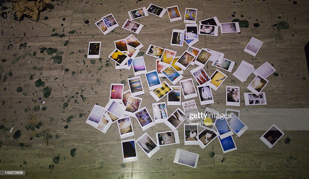 Instant photographs scattered : Stock Photo