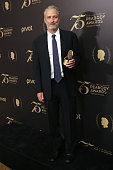 Institutional Award Recipient The Daily Show with Jon Stewart comedian/television host Jon Stewart poses for photographs in the press room during the...
