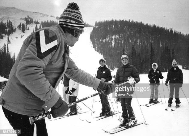 Instruction Begins In PostGartSchaeffler Ski School Doug Anderson of teaching staff at Loveland Basin Ski Area instructs students on getting on a...
