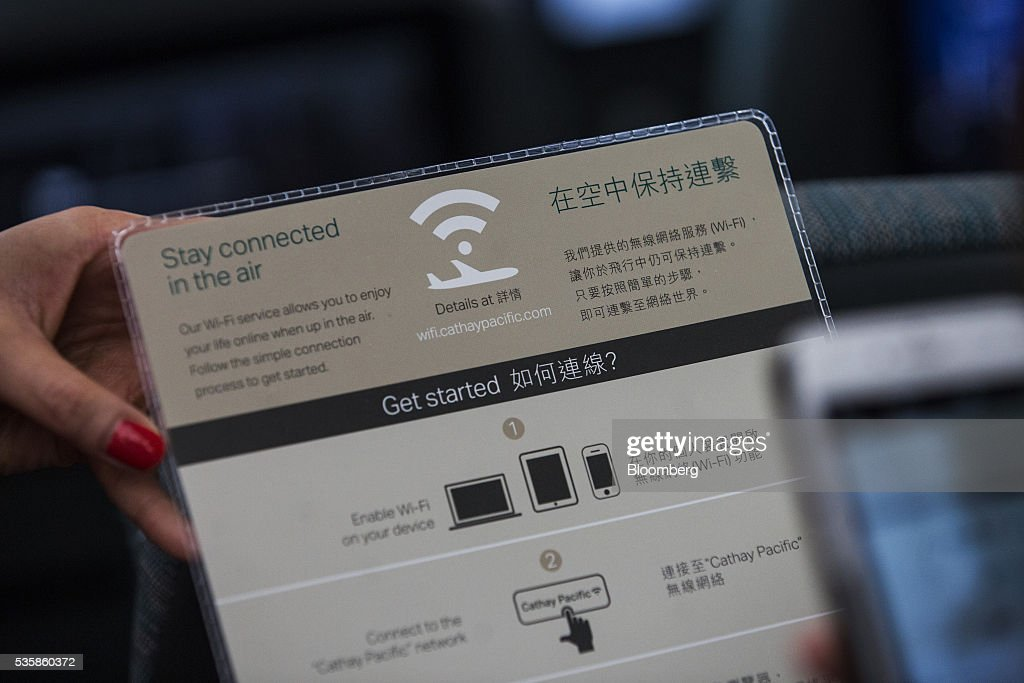 Instruction for in-flight wifi is seen onboard an Airbus Group SE A350-900 aircraft operated by Cathay Pacific Ltd. during a media event in Hong Kong, China, on Monday, May 30, 2016. Airbus stuck to plans to increase plane deliveries this year as it pushes to overcome a series of problems affecting production of its newest aircraft. Photographer: Justin Chin/Bloomberg via Getty Images